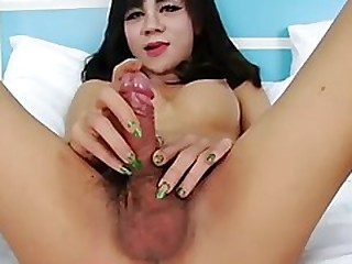 Breasty oriental tgirl jill t enjoys jerking off