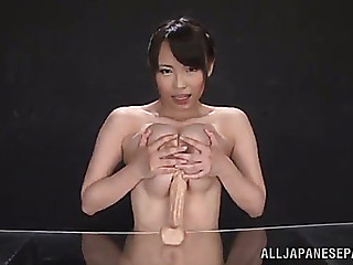 Breasty jap playgirl gives 10Pounder shaped vibrator a titjob